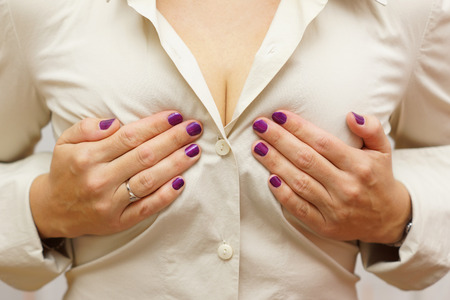 female breast: woman holding her breasts Stock Photo