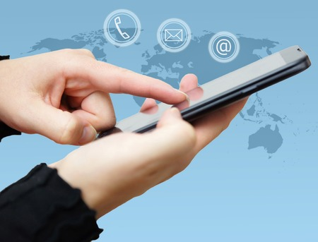 woman dialing phone number: woman is using smart mobile phone with icons mail, phone,email around Stock Photo