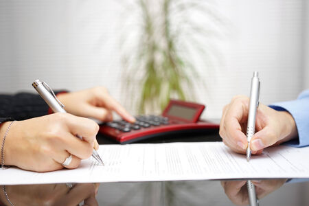 lawyer and client completing contract and prices photo