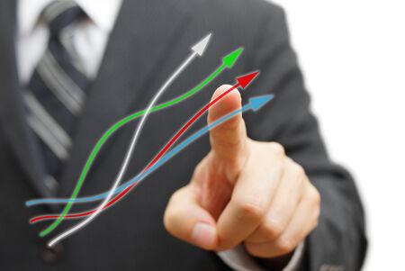 Businessman touching growing arrows. Positive trend concept photo