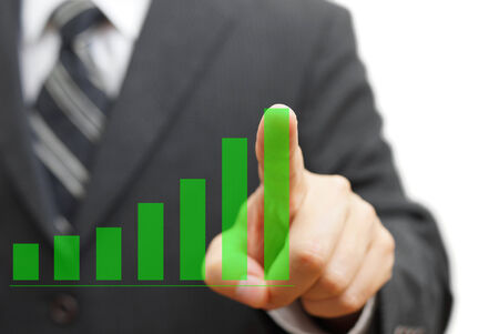 good investment: businessman touching growing virtual graph column. Positive trend concept