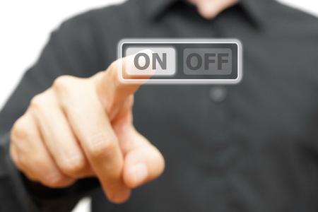 restart: man hand pressing ON button