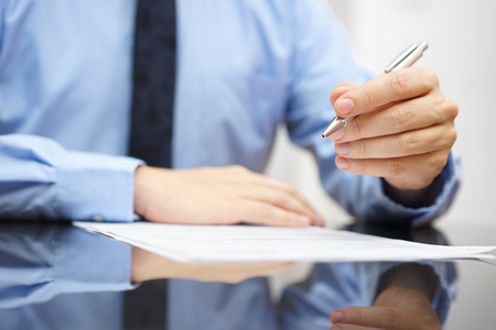Businessman on meeting is commenting document