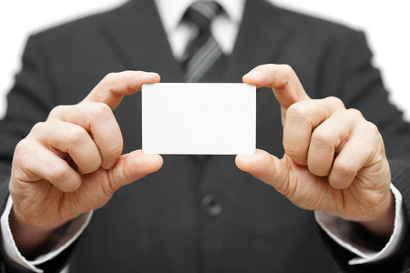 businessman hold business card , company identity photo