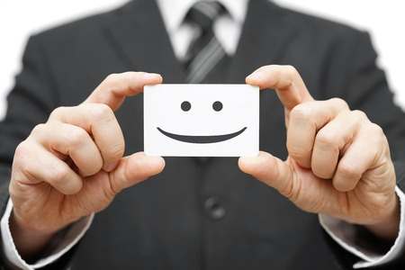 satisfied customer: our clients are happy clients, smile on business card Stock Photo