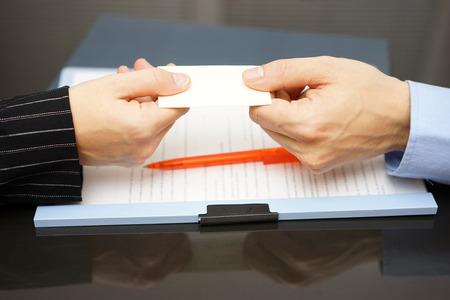 acquaint: business partner is receiving business card
