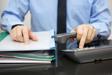 tax consultants: Businessman is calling for support when received a lot of documentation. consultant  is required