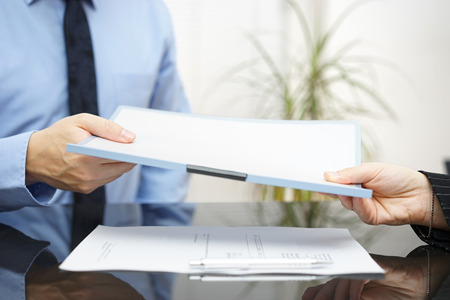 Man and woman are exchanging contract or document