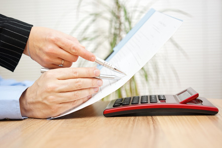 mortgage document: Lawyer and his client are examining legal document Stock Photo
