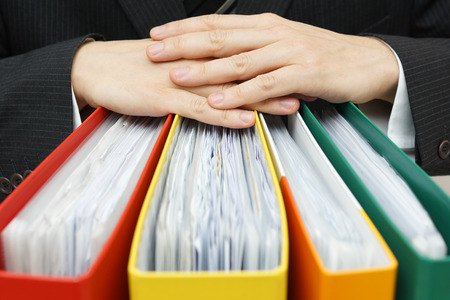 firms: concept of paperwork,accounting, administration businessman holding documentation Stock Photo