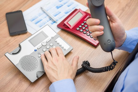 occupied: Occupied businessman with report  is calling client for explanation