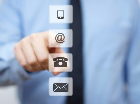 email us: businessman pressing email button, company support icons
