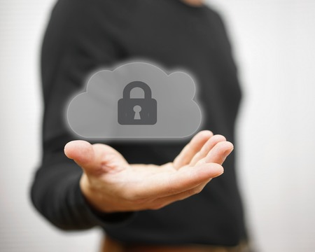 Safe online files and  remote informations. man holding locked cloud icon Stock Photo