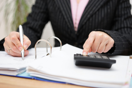 bookkeeping: busy female accountant working with documents Stock Photo