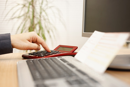 indebted: Man is calculating how much money he need to pay the bills