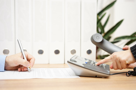 phone calls: Colleague in the office are fully busy with the paperwork and phone calls