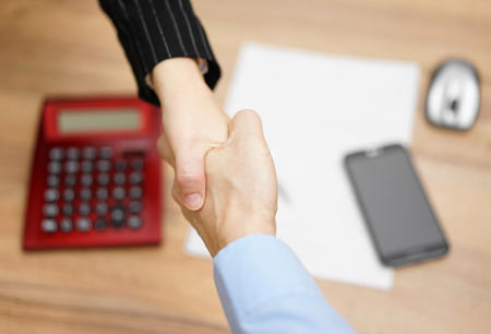 hand job: Top view of businesswoman shaking  hand  with businessman  after negotiation