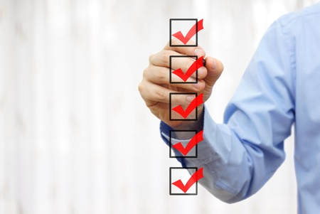 businessman checking final  mark on checklist 스톡 콘텐츠