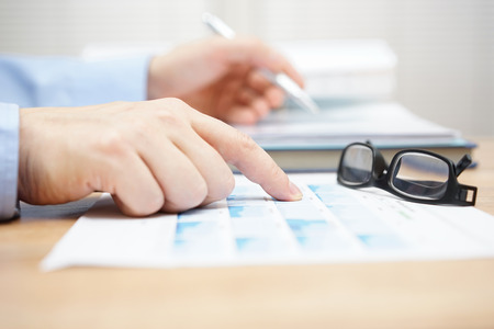 financial consultant is reviewing investment portfolio