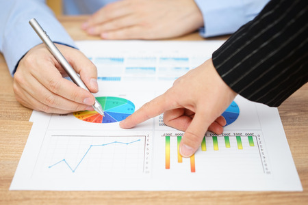 sales report: businesswoman showing sales report to his client Stock Photo
