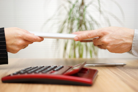 documentation: Businesswoman gives  documentation to his client Stock Photo