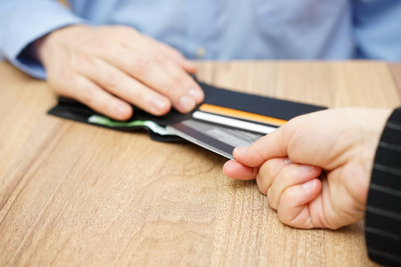 woman take credit card from man Stock Photo