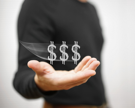 honorarium: man catches virtual dollar sign, concept of income,salary,earning Stock Photo