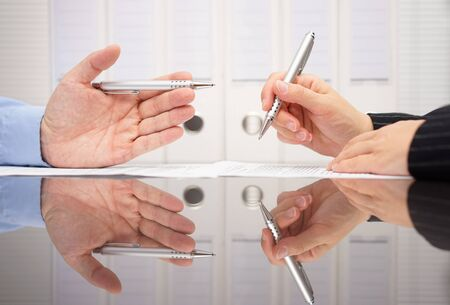 two hands: business people are discussing about  business data Stock Photo
