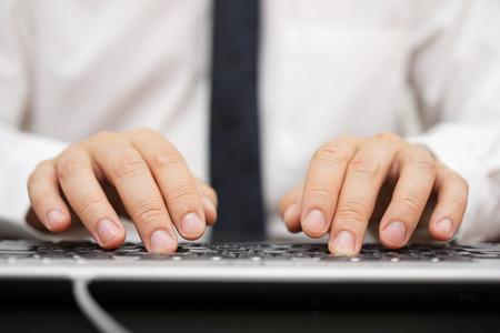feedback: closeup of businessman hands typing on computer keyboard