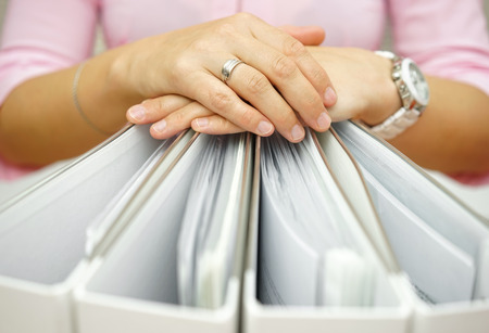 bureaucracy: Secretary holding binders, concept of accounting,business,documentation,paperwork Stock Photo