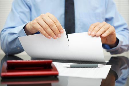 failure: businessman tears document in office Stock Photo