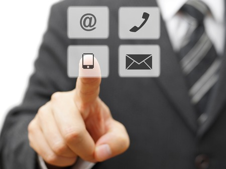 Businessman choosing virtual contact icon Banque d'images