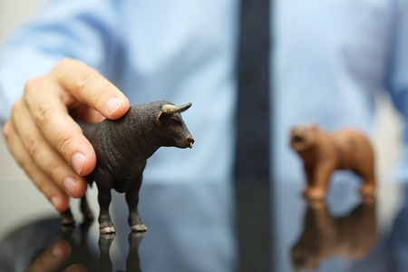 businessman holding bull, concept of bullish trend on stock market Standard-Bild