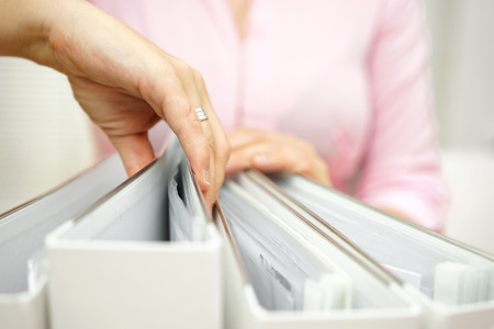 regulated: businesswoman is inspecting documentation Stock Photo