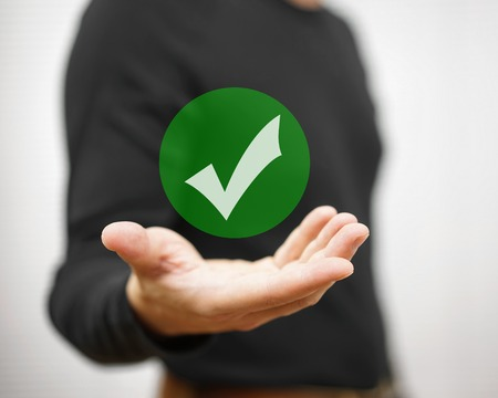 the concept is correct: Businessman showing green check mark. Concept of correct decision
