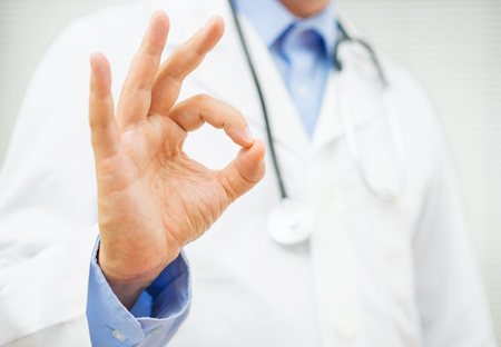 ok sign: doctor showing ok sign, concept of healty man or trusting a doctor