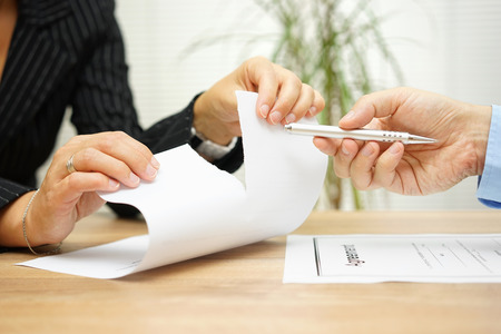 Woman tears agreement documents  in front of agent who wants to get  a signature
