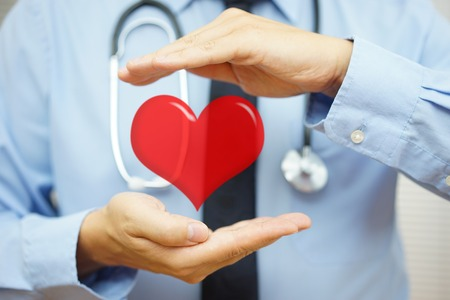 doctor is protecting heart  with hands. Health care and  Cardiovascular diseases  concept