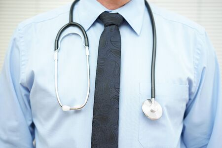 physicians: crop of physician  with stethoscope over blue shirt