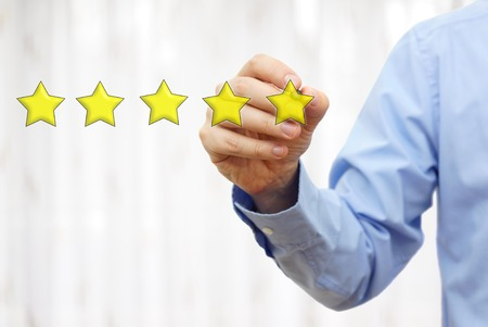 job satisfaction: businessman drawing five star rating,concept of quality and luxury