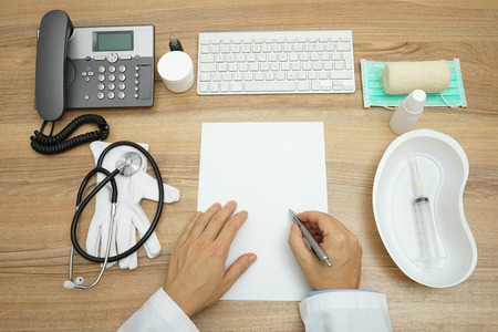 pathologist: top view of doctor writing medical report