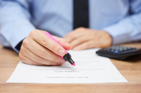 important: businessman is preparing to examine legal document and highlight important information