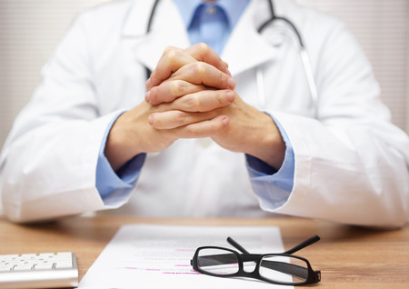 doctor patient: Doctor is communicating with patient