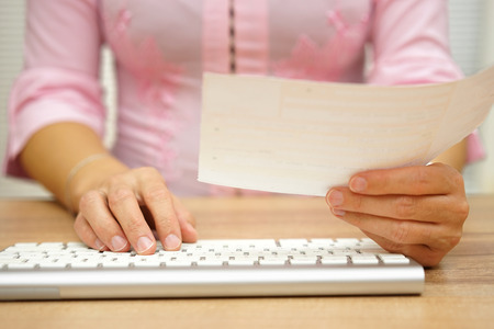 over paying: Woman is paying electricity bill over internet