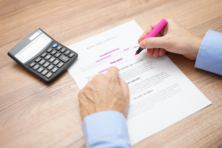 control fraud: businessman is reviewing and checking agreement  and indicates important text Stock Photo