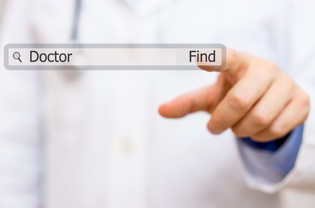 searchbar: doctor pressing find doctor  on virtual search bar. concept of use of internet for medical assistance