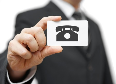 holding business card: businessman holding business card with telephone icon, call us concept