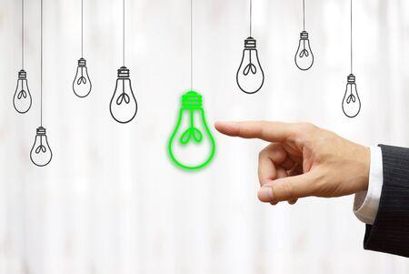 green light bulb: businessman choose green light bulb, idea & environment concept