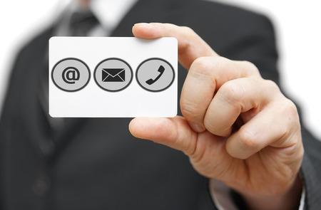 Geschäftsmann halten Visitenkarte mit Identifikationssymbolen. Support-Center-Symbole Lizenzfreie Bilder
