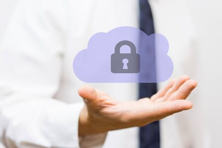 Businessman holding protected cloud, concept of  business cloud storage solutions